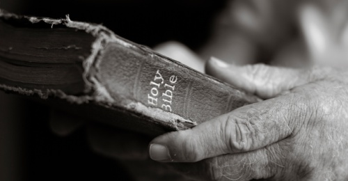 Bible in hands