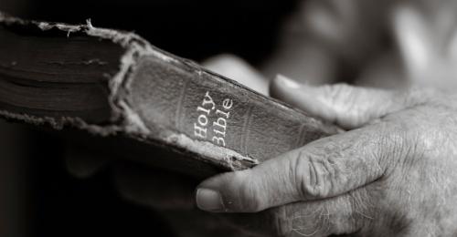 Bible in hands